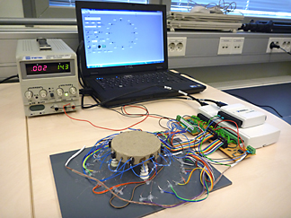 A prototype version including 8 independently controllable heating elements and 16 temperature measuring thermistors.