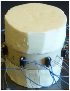 Measurement of a mortar disk with a cylindrical (air) defect. The top and bottom surfaces of the target are insulated with styrofoam, leading to (approximately) zero flux at the top and bottom surfaces